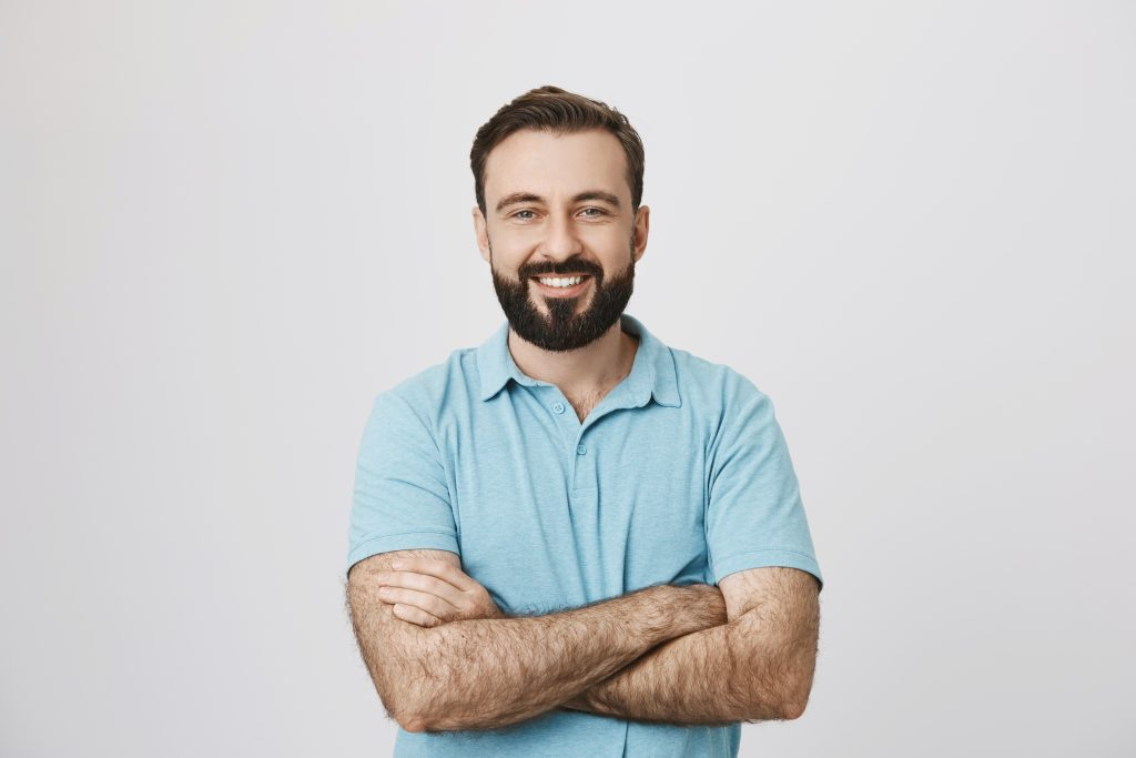Portrait,Of,A,Handsome,Bearded,Man,Smiling,Looking,To,The