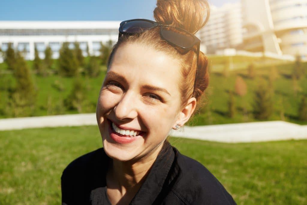 Headshot,Of,Happy,Pretty,Teenage,Girl,With,Bun,Hairstyle,Looking