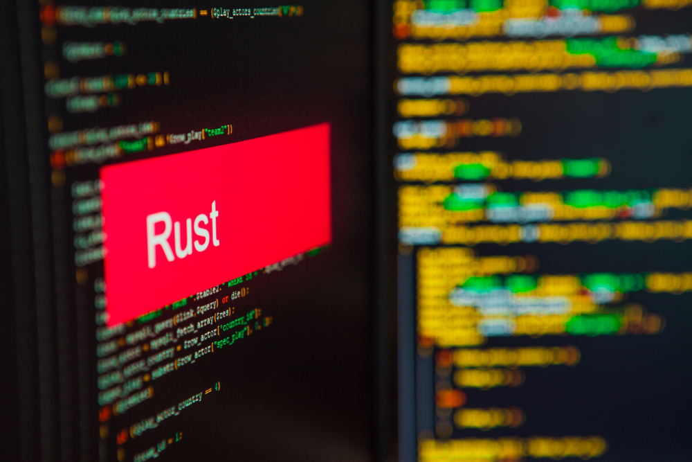 Programming,Language,,Rust,Inscription,On,The,Background,Of,Computer,Code.